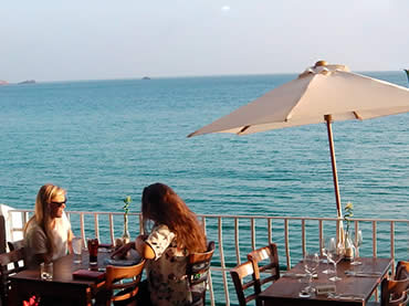 Customers dining on the balcony at Sugareef Restaurant St Brelades Jersey
